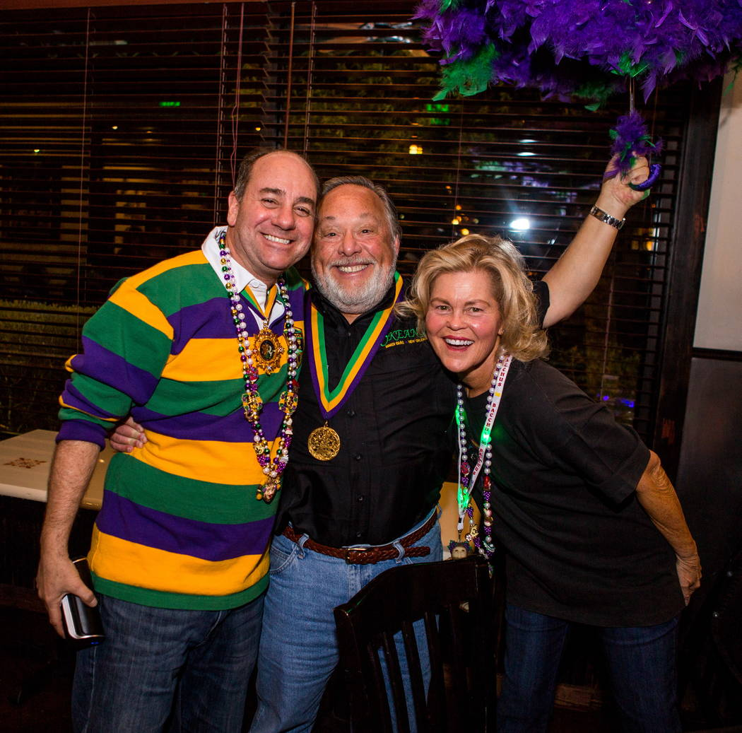 Members of the Krewe of Okeanos, from left, Ken Misch, a former king, Marc Vennart, king, and his wife, Joan Vennart, at Lola's in Summerlin on Saturday, Feb. 3, 2018.  Patrick Connolly Las Vegas  ...