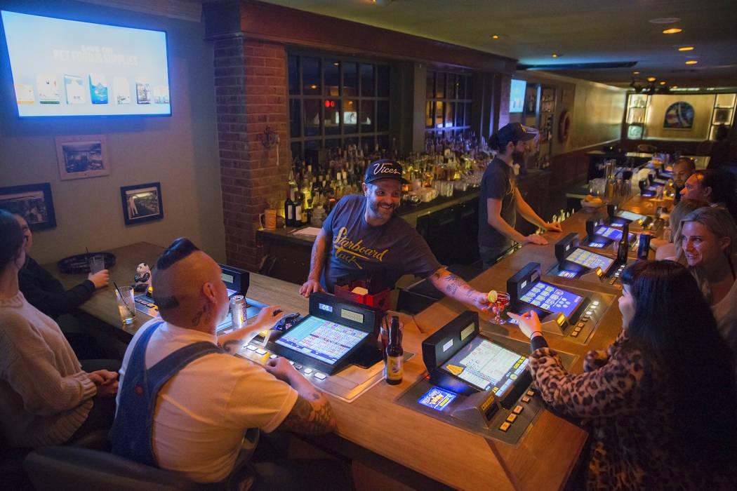 Bartender Isiah Thorton, middle, serves an Atlantico on Atlantic at Starboard Tack on Saturday, February 3, 2018, in Las Vegas. Benjamin Hager Las Vegas Review-Journal @benjaminhphoto