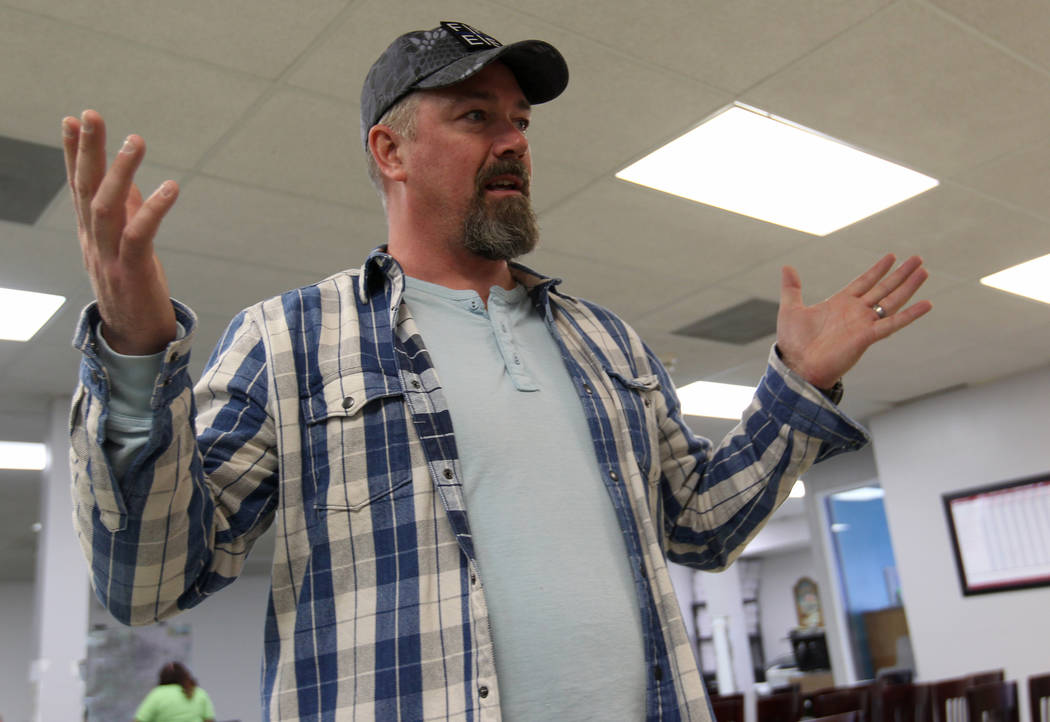 Mike Bartel, co-founder and executive director of Find Restore Embrace Empower (F.R.E.E.) International, talks to a reporter during The Big Search campaign at the Las Vegas F.R.E.E. International  ...