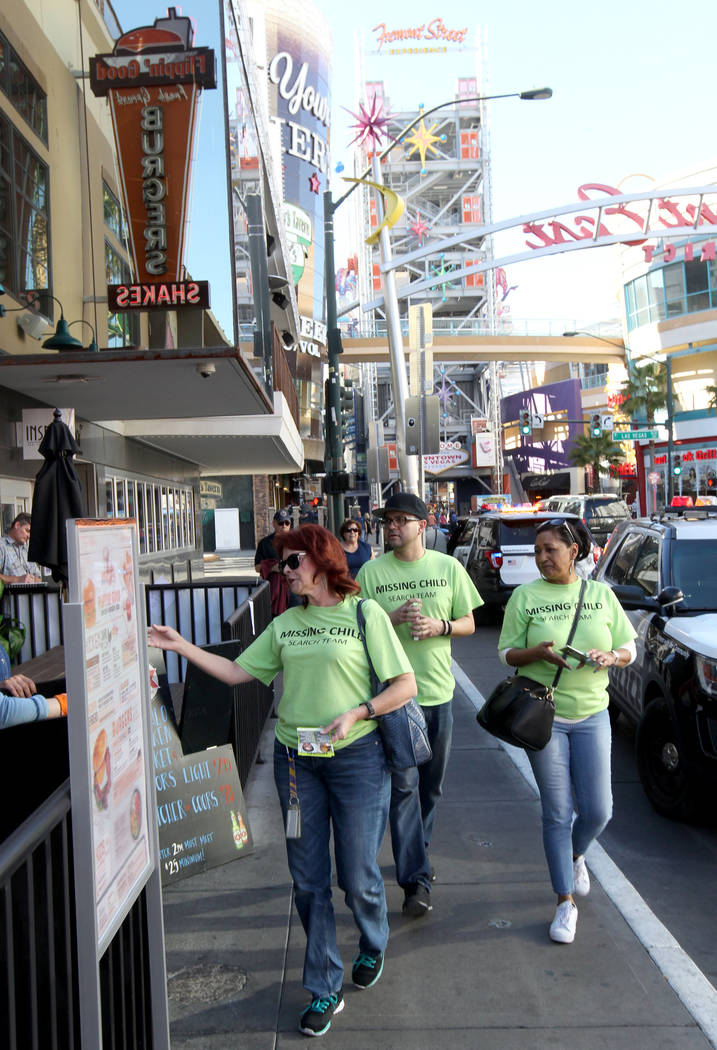 Annette Adams, from left, Roberto Garcia and Wanda Ramsey hand out flyers with photos of missing children on East Fremont Street during The Big Search campaign Friday, Feb. 2, 2018. Volunteers dis ...