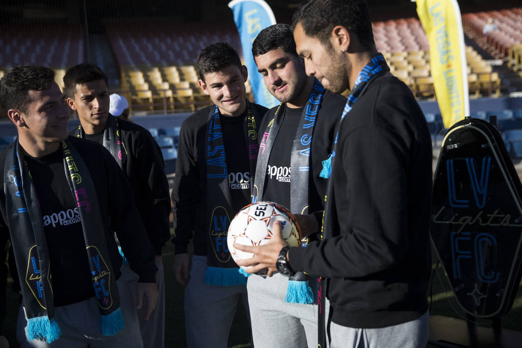 Las Vegas Lights FC players from left, Julian Portugal, Adolfo Guzman, Matt Thomas, Marco Cesar Jaime, and Sebastian Hernandez, during an event to lay the first pieces of turf at Cashman Field to  ...