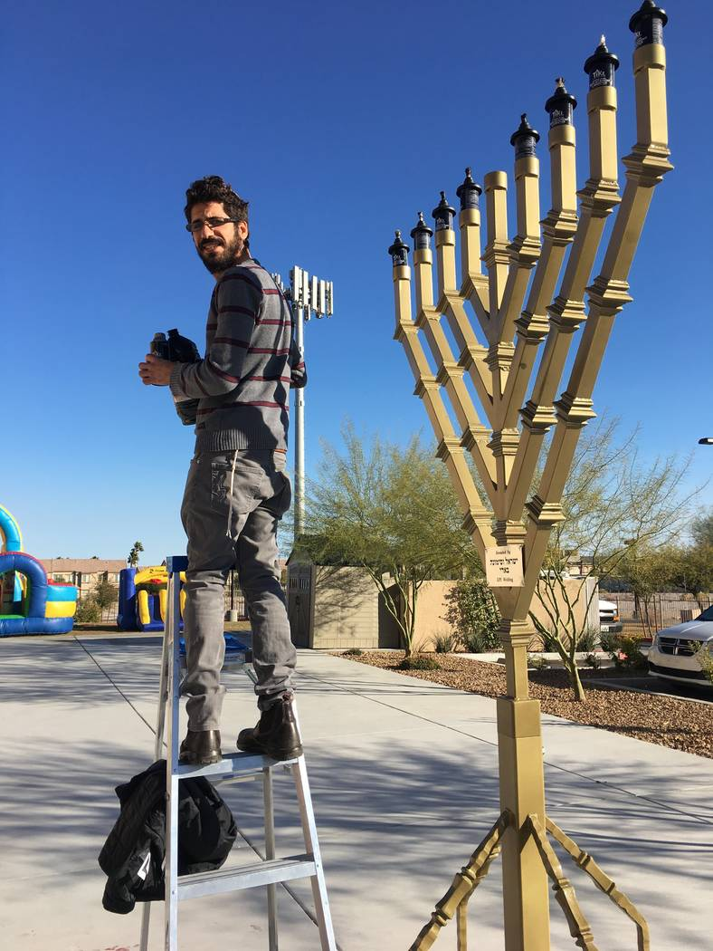 Shimon Abta prepares for Hanukkah. Courtesy of Esther Abta.