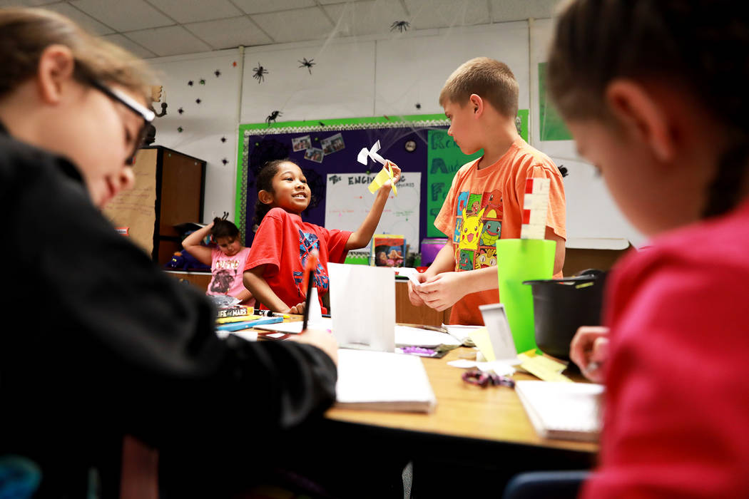 Devon Jernigan, 9, and Jake Stadler, 8, work on a class assignment