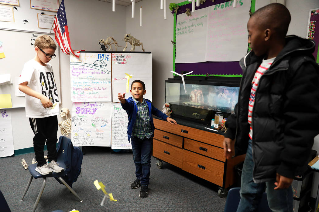 Ra-ra Sims, 9, from left, Ronaldo Calvo, 10, and Ismael Aka, 8, work on a class assignment at Doris French Elementary School, which went from being ranked two stars to five stars, in Las Vegas, Fr ...
