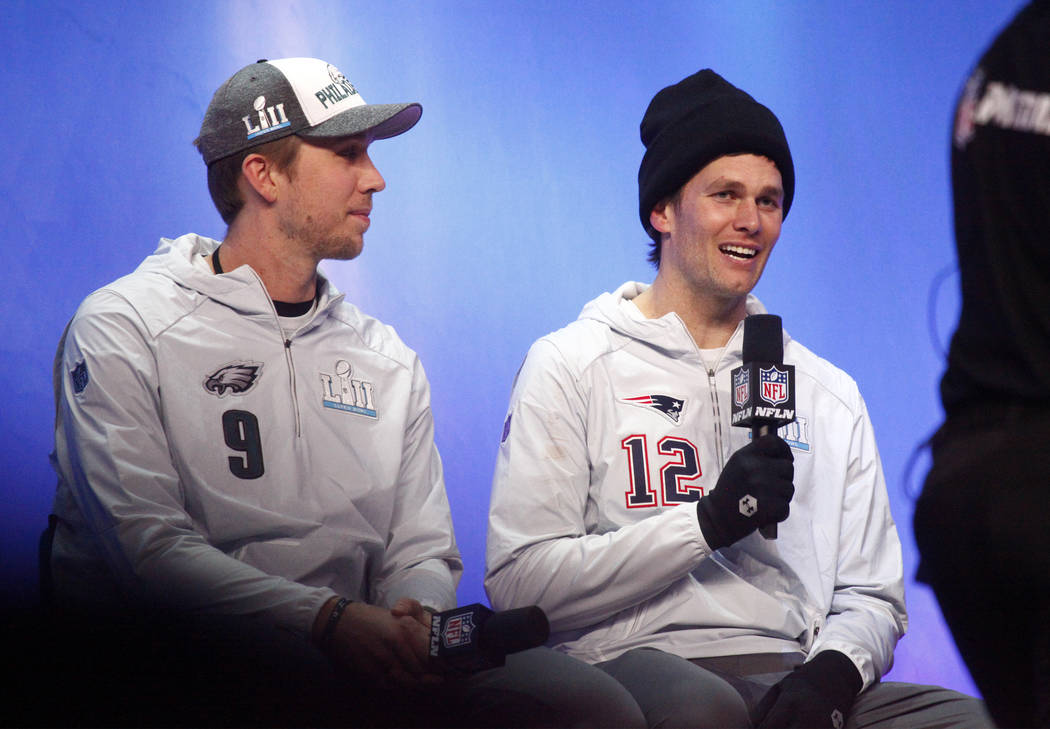 Philadelphia Eagles quarterback Nick Foles, left, on stage with New England Patriots quarterback Tom Brady during Opening Night at the Xcel Energy Center in St. Paul, Minn., Monday, Jan. 29, 2018. ...