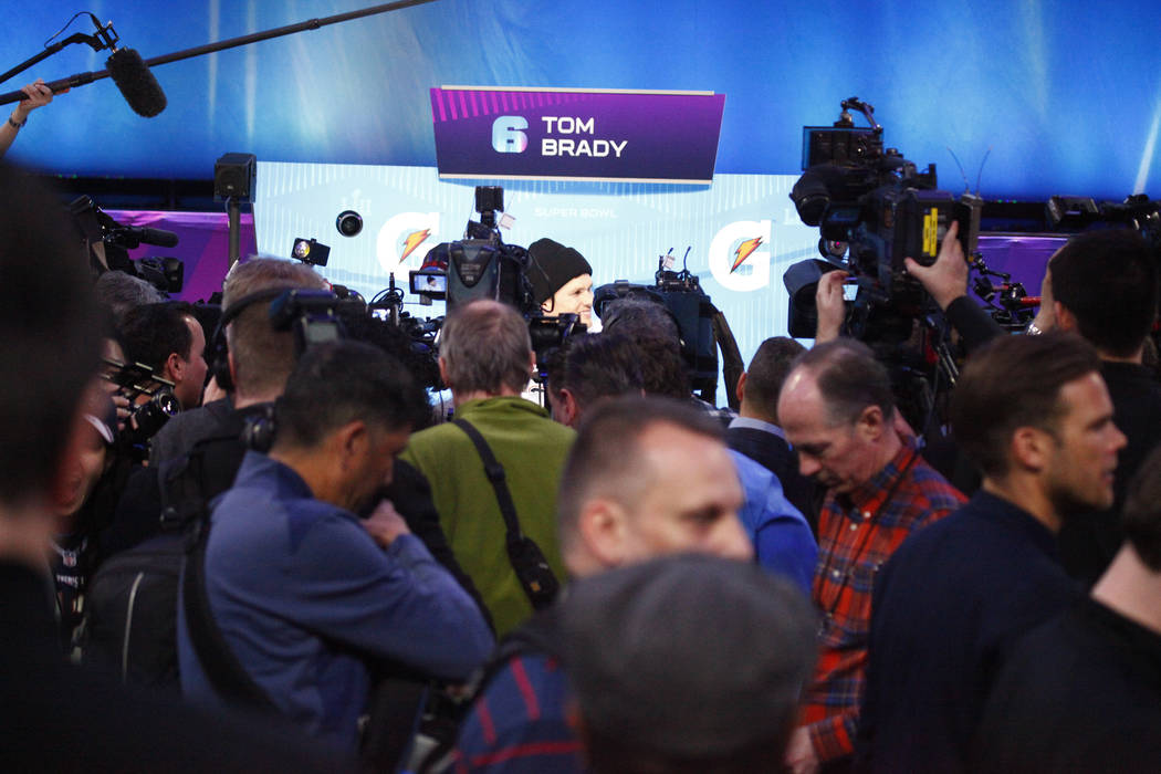 New England Patriots quarterback Tom Brady is surrounded by media Super Bowl 52 Opening Night at the Xcel Energy Center in St. Paul, Minn., Monday, Jan. 29, 2018. Heidi Fang Las Vegas Review-Journ ...