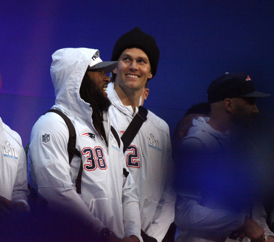 New England Patriots quarterback Tom Brady (12) on stage with running back Brandon Bolden (38), during Super Bowl 52 Opening Night at the Xcel Energy Center in St. Paul, Minn., Monday, Jan. 29, 20 ...