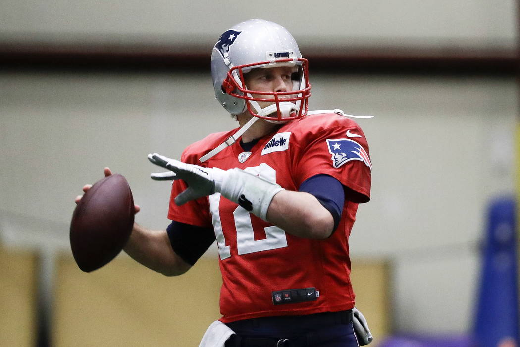 New England Patriots quarterback Tom Brady throws during a practice Wednesday, Jan. 31, 2018, in Minneapolis. The Patriots are scheduled to face the Philadelphia Eagles in the NFL Super Bowl 52 fo ...