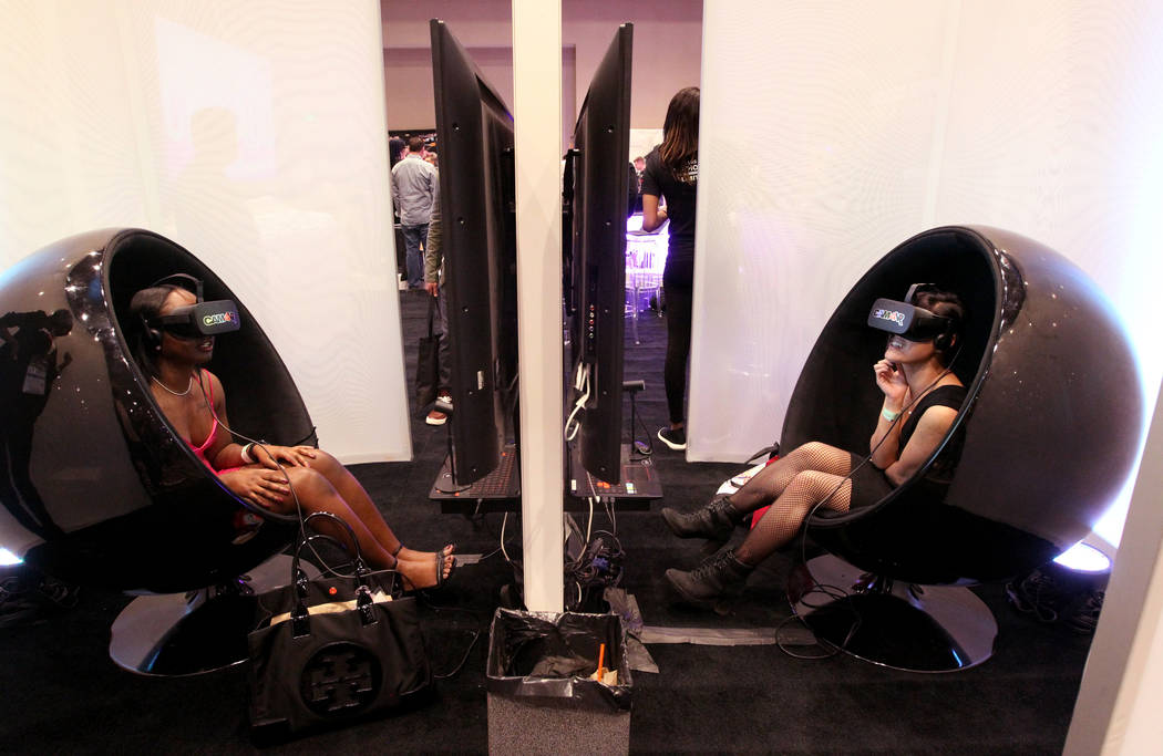 Lana and Kim Chi check out CAM4VR 3D 360¡ virtual reality environment headsets during AVN Adult Entertainment Expo at the Hard Rock Hotel in Las Vegas Friday, Jan. 26, 2018. K.M. Cannon Las V ...