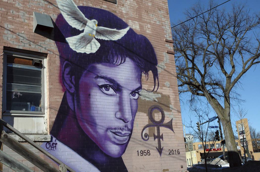 """In this Jan. 29, 2018 photo, a painting of the late Prince is shown on a Minneapolis building. Fans remember Prince for his electrifying halftime performance at the Super Bowl in 2007. The """"Purp ..."""