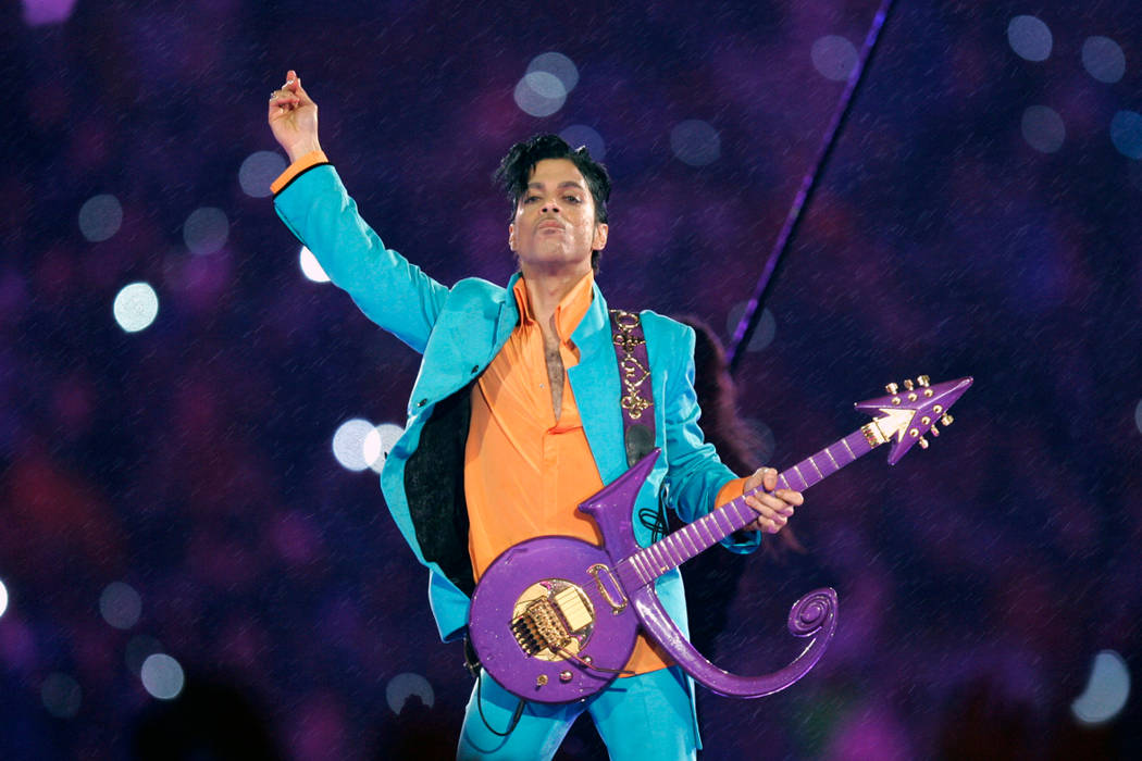 """Prince performs during the halftime show at the Feb. 4, 2007, Super Bowl XLI at Dolphin Stadium in Miami. Fans remember Prince for his electrifying halftime performance at the Super Bowl. The """"P ..."""