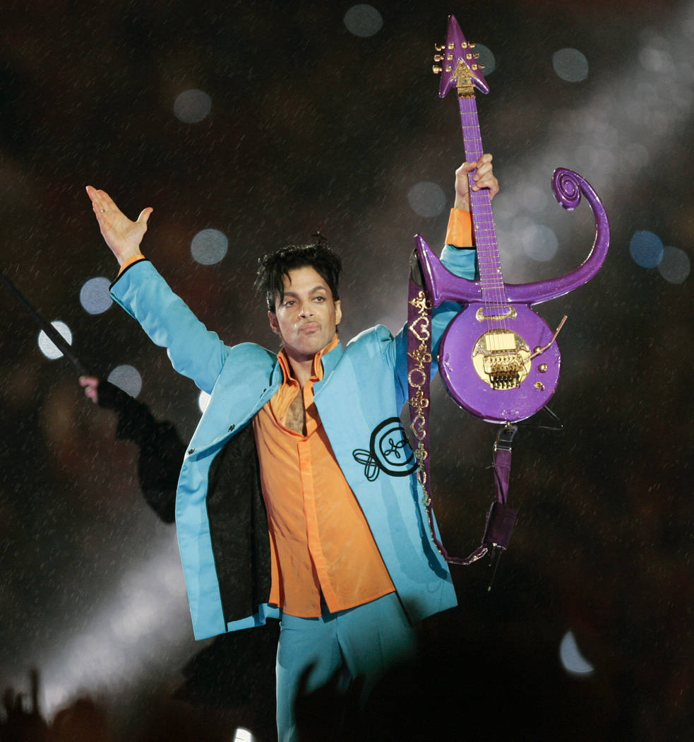 Prince performs during the halftime show at the Feb. 4, 2007 Super Bowl XLI football game at Dolphin Stadium in Miami. Fans remember Prince for his electrifying halftime performance at the Super B ...