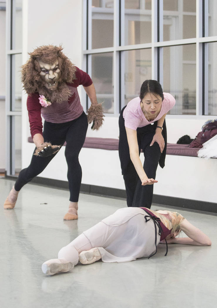 "Leslie Youg, middle, works with Sergio Alvarez, left, and Emma McGirr during rehearsal for the Nevada Ballet Theatre's ""Beauty and the Beast"" on Tuesday, Feb. 6, 2018, at Nevada Ballet Theatre in  ..."