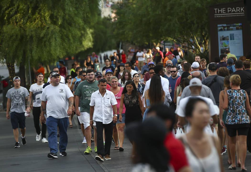 Tourists walk along the Las Vegas Strip in this file photo. Chase Stevens Las Vegas Review-Journal @csstevensphoto