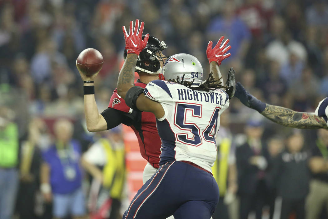 New England Patriots Dont'a Hightower #54 sacks and forces a fumble against the Atlanta Falcons QB Matt Ryan #2 at Super Bowl 51 on Sunday, February 5, 2017 in Houston, TX. (AP Photo/Gregory Payan)
