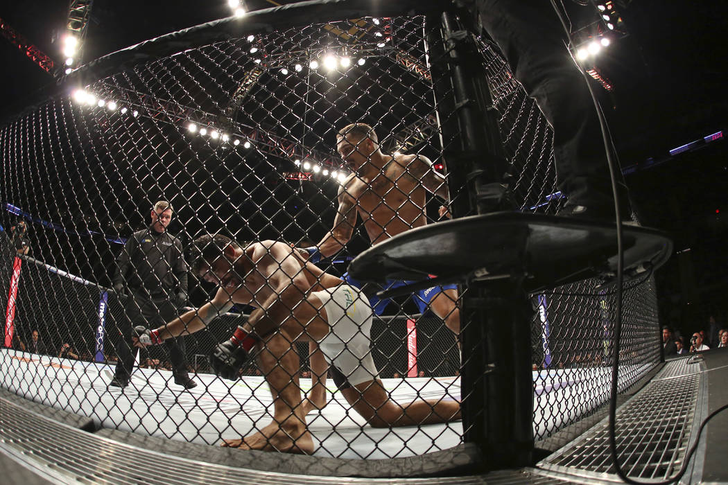Eryk Anders knocks out Rafael Natal during their mixed martial arts bout at UFC on Fox 25, Saturday, July 22, 2017, in New York. Anders won via 1st round KO. (AP Photo/Steve Luciano)
