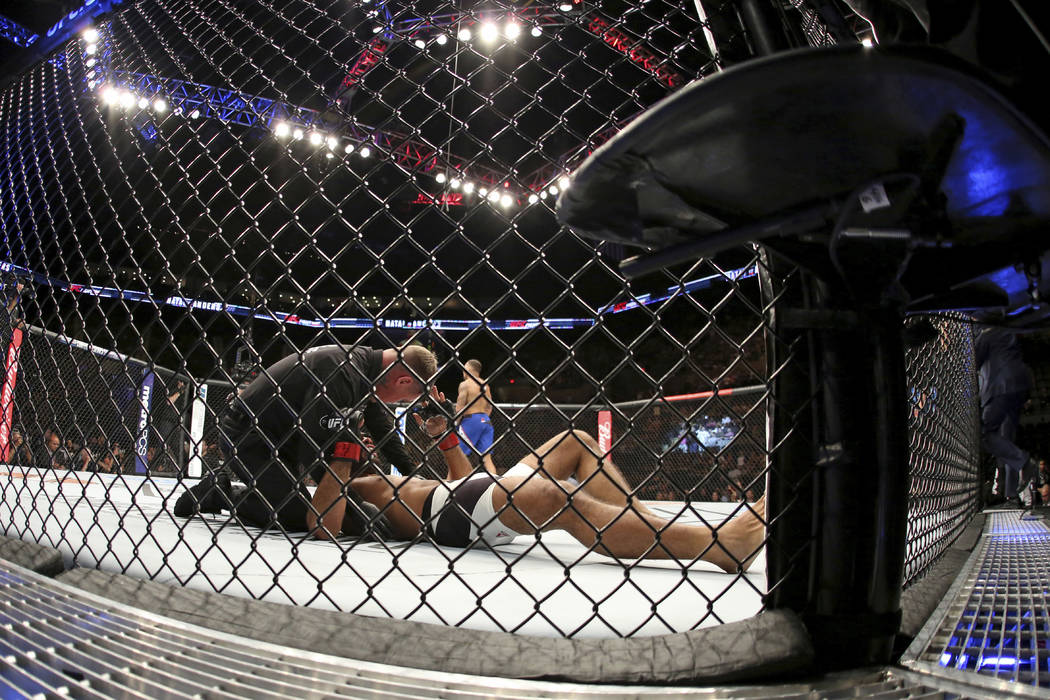 Rafael Natal is seen on the canvas after being knocked out by Eryk Anders during their mixed martial arts bout at UFC on Fox 25, Saturday, July 22, 2017, in New York. Anders won via 1st round KO.  ...