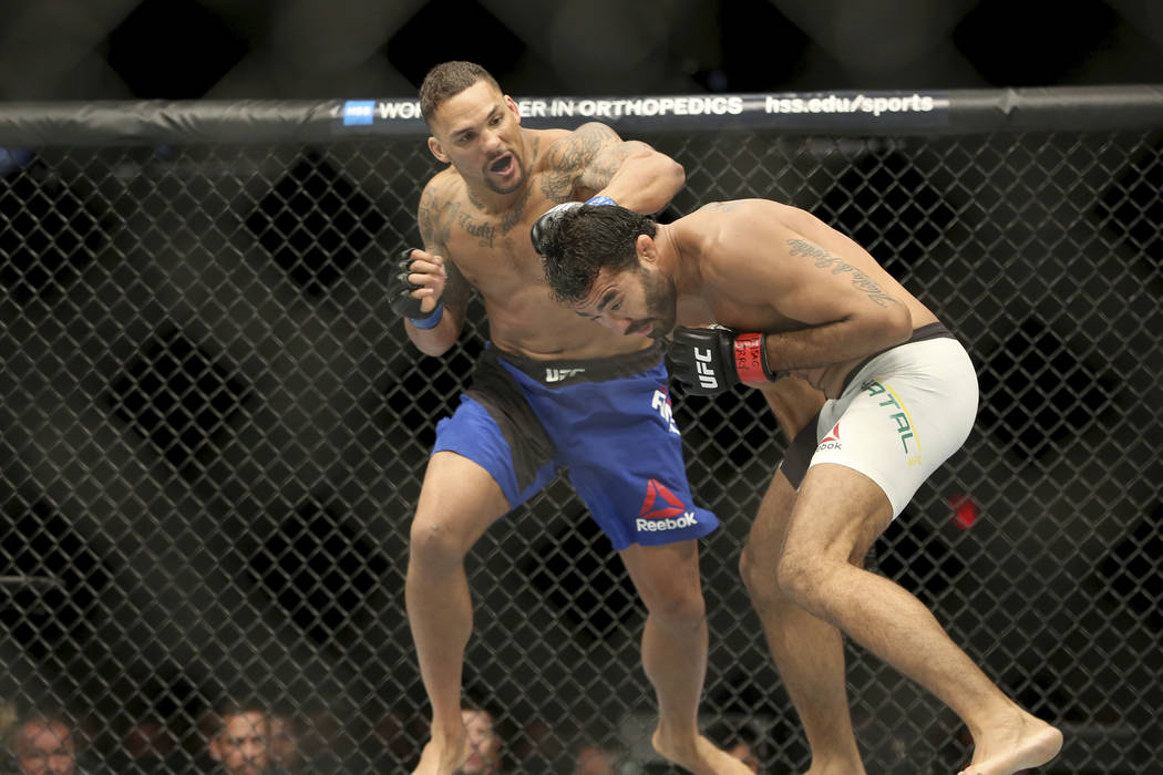 Eryk Anders, left, in action against Rafael Natal during their mixed martial arts bout at UFC on Fox 25, Saturday, July 22, 2017, in New York. Anders won via 1st round KO. (AP Photo/Steve Luciano)