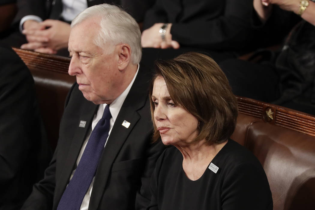 House Minority Leader Nancy Pelosi of California and Minority Whip Steny Hoyer, D-Md., listen to the State of the Union address to a joint session of Congress on Capitol Hill in Washington, Tuesda ...