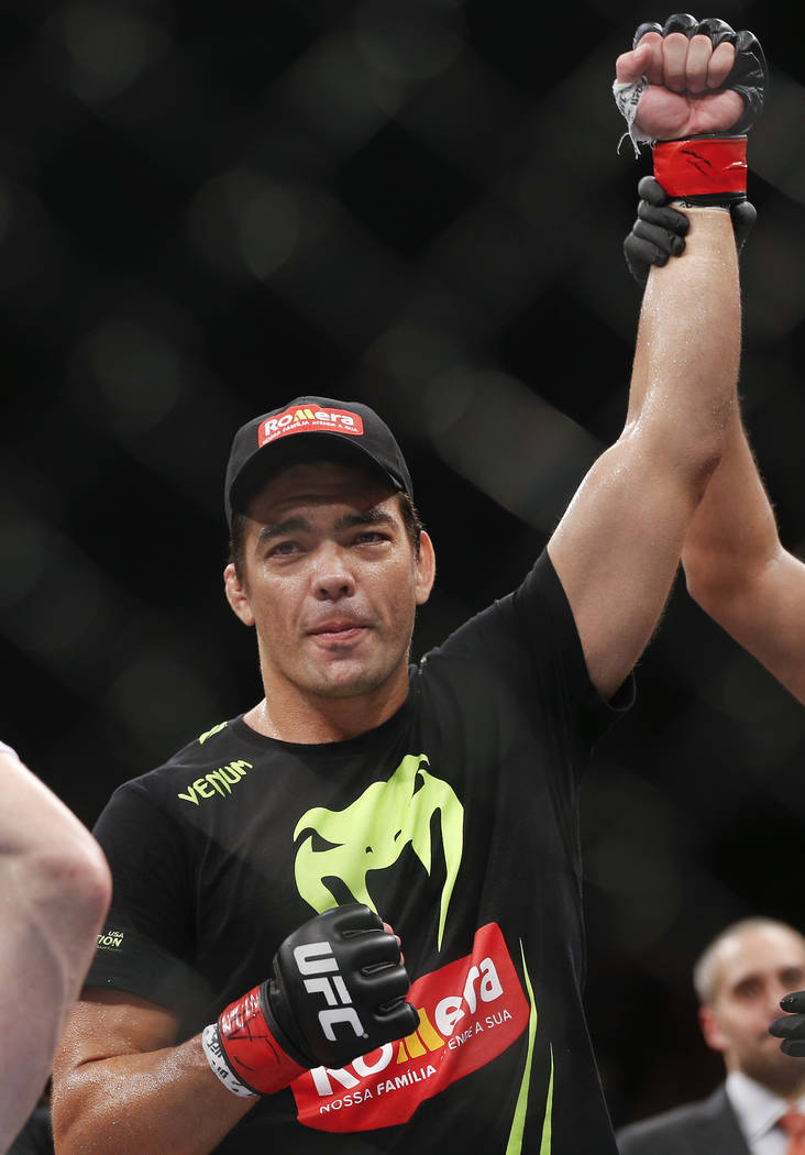 Lyoto Machida, from Brazil, celebrates after defeating CB Dollaway, from the United States, during their middleweight UFC mixed martial arts bout in Barueri, on the outskirts of Sao Paulo, Brazil, ...