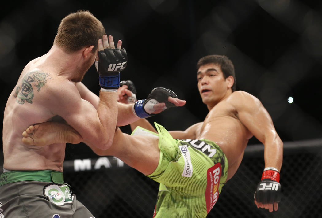 Lyoto Machida, right, from Brazil, fights CB Dollaway, from the United States, during their UFB middleweight mixed martial arts bout in Barueri, on the outskirt of Sao Paulo, Brazil, early Sunday, ...