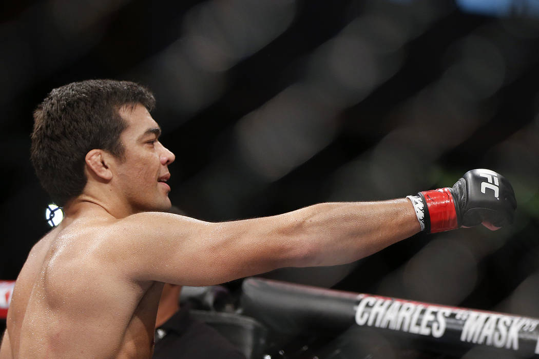 Lyoto Machida, from Brazil, celebrates after defeating CB Dollaway, from the United States, during their UFC middleweight mixed martial arts bout in Barueri, on the outskirts of Sao Paulo, Brazil, ...