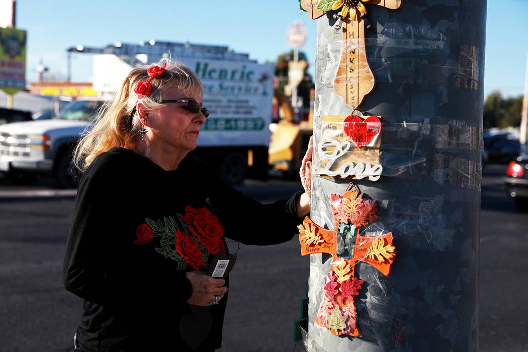 Leslie Ortega, 65, visits a memorial for her late husband near the scene of a 2016 car accident at the intersection of Nellis Boulevard and Washington Avenue in Las Vegas on Tuesday, Feb. 6, 2018. ...