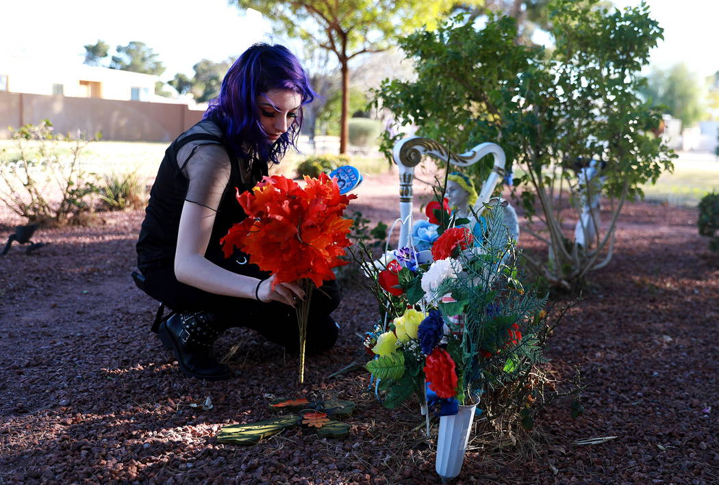 Faith Hubbard, 19, visits a memorial for her grandfather at a community garden in Winterwood Village in Las Vegas on Tuesday, Feb. 6, 2018. Hubbard survived the accident that killed her grandfathe ...