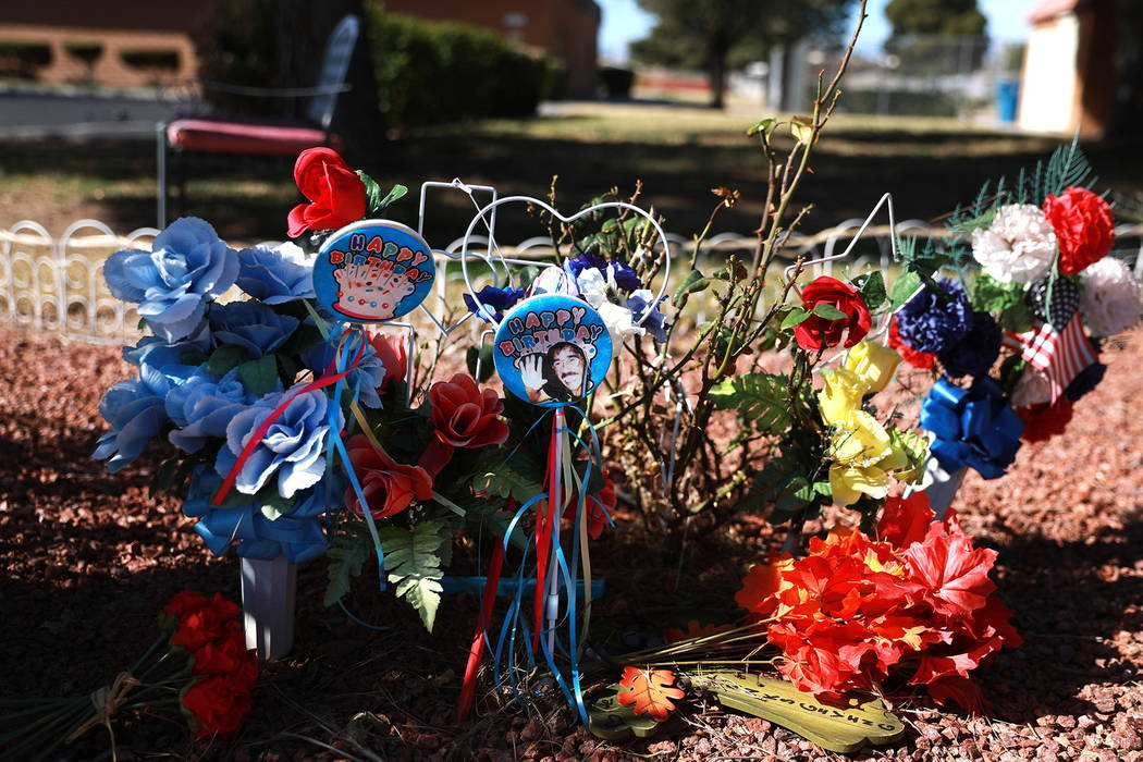 A memorial for Quirino Ortega is decorated by his widow, Leslie Ortega, and granddaughter, Faith Hubbard, ata community garden in Winterwood Village in Las Vegas on Tuesday, Feb. 6, 2018. An ...