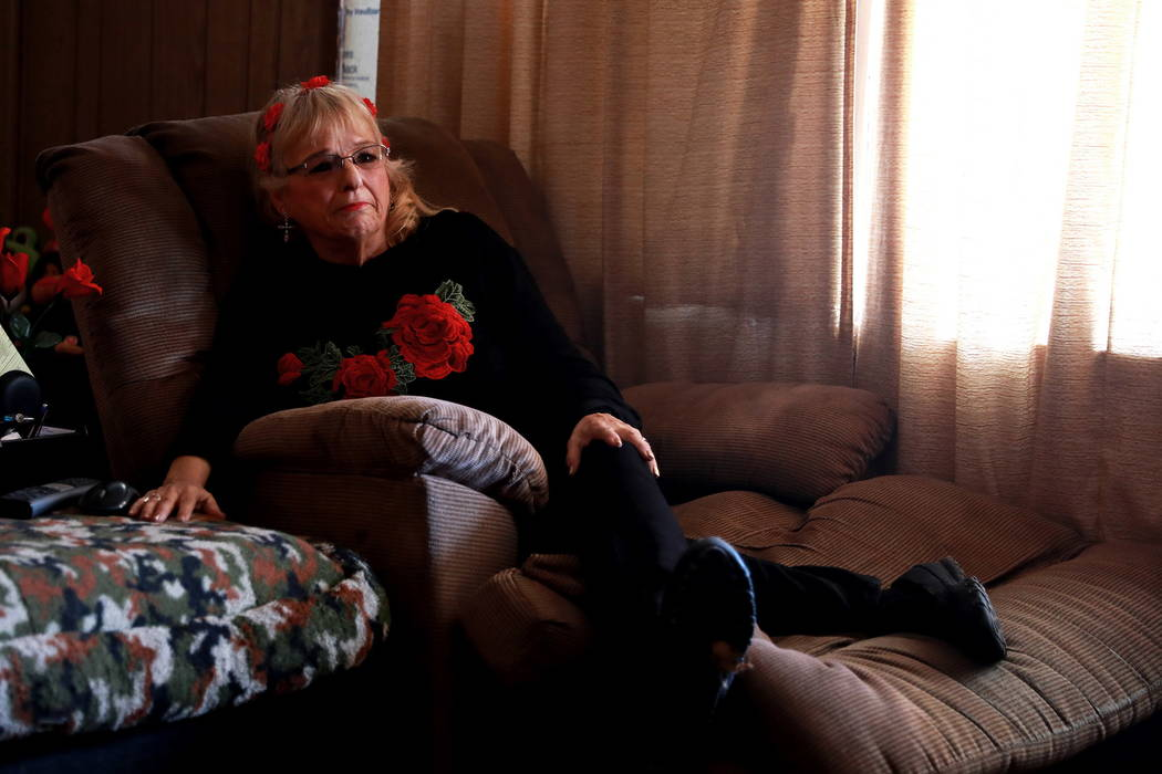 Leslie Ortega tears up while watching home videos of her late husband, who she nicknamed Nino, at her home in Winterwood Village in Las Vegas on Tuesday, Feb. 6, 2018. The couple was married for 3 ...