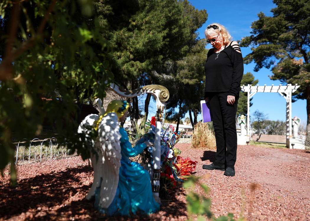 """Leslie Ortega visits her late husband's memorial at a community garden in Winterwood Village in Las Vegas on Sunday, Feb. 4, 2018. """"As long as I'm alive, he's in every moment,"""" s ..."""