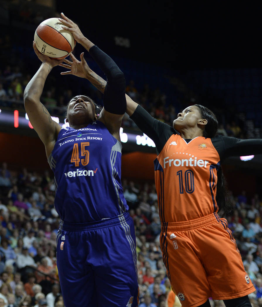 Phoenix Mercury's Kelsey Bone, left, goes up for a basket against Connecticut Sun's Courtney Williams, right, during the second half of a WNBA basketball game, Friday, Sept. 2, 2016, in Uncasville ...