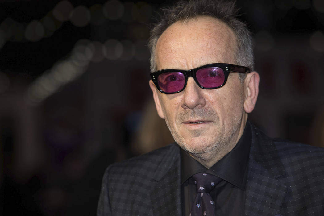 Musician Elvis Costello poses for photographers upon arrival at the premiere of the film 'Film Stars Don't Die in Liverpool' showing as part of the BFI London Film Festival in London, Wednesday, O ...