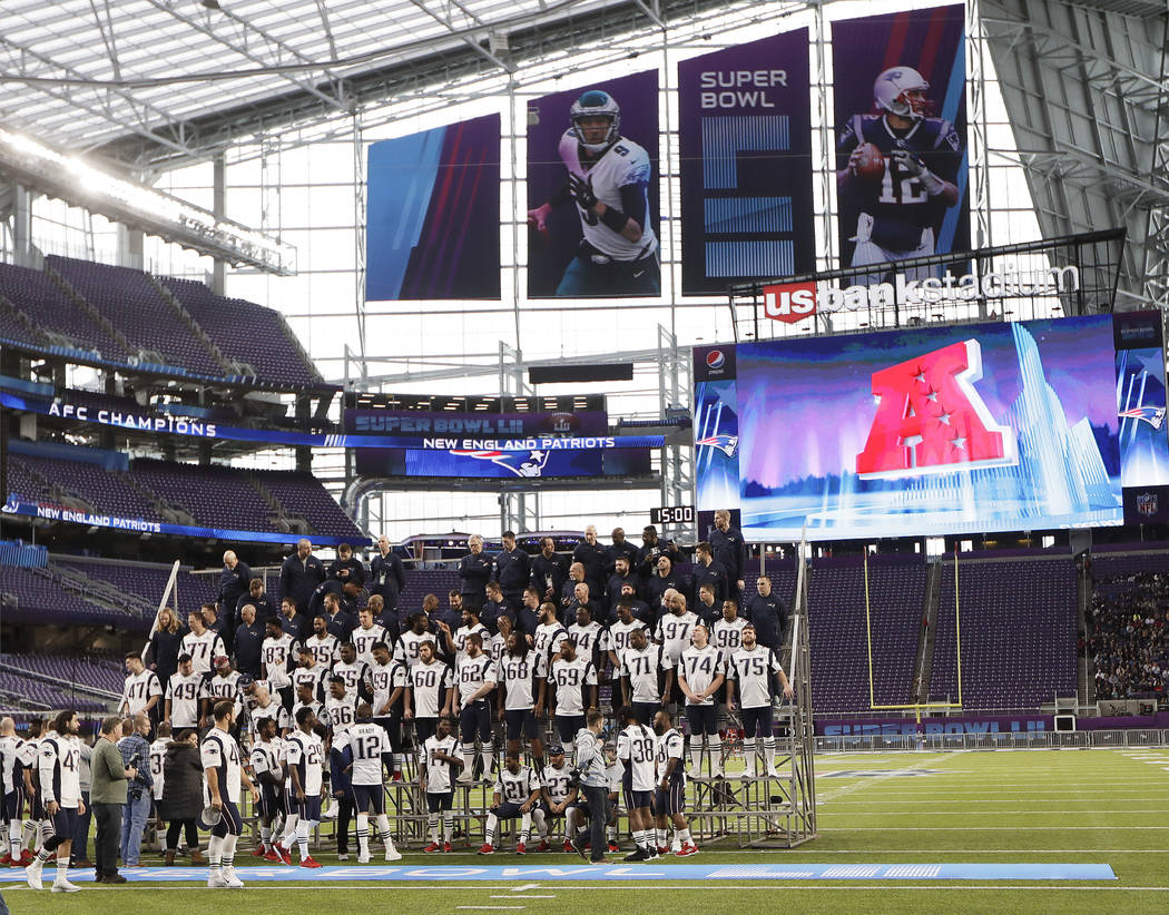 The New England Patriots assemble for their team photo in U.S. Bank Stadium Saturday, Feb. 3, 2018, in Minneapolis. The Patriots are scheduled to face the Philadelphia Eagles in the NFL Super Bowl ...