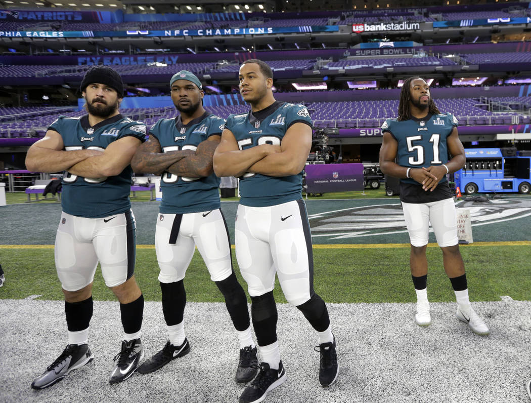 From left, Philadelphia Eagles inside linebacker Joe Walker, outside linebacker Nigel Bradham, middle linebacker Jordan Hicks, and defensive end Steven Means (51) prepare for a walk through for th ...