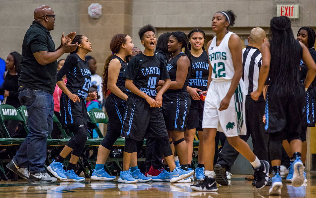 Canyon Springs players celebrate after defeating Rancho 58-38 at Rancho High School in Las Vegas on Tuesday, Feb. 6, 2018.  Patrick Connolly Las Vegas Review-Journal @PConnPie