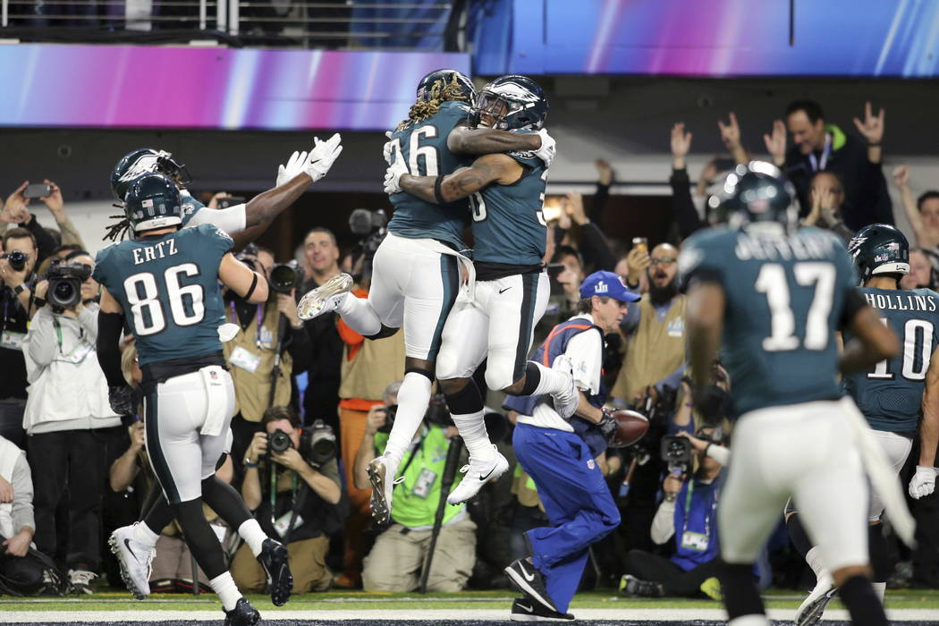 Philadelphia Eagles running back Corey Clement celebrates with Jay Ajayi after Clement's second half touchdown against the New England Patriots in Super Bowl 52 on Sunday, February 4, 2018 in Minn ...