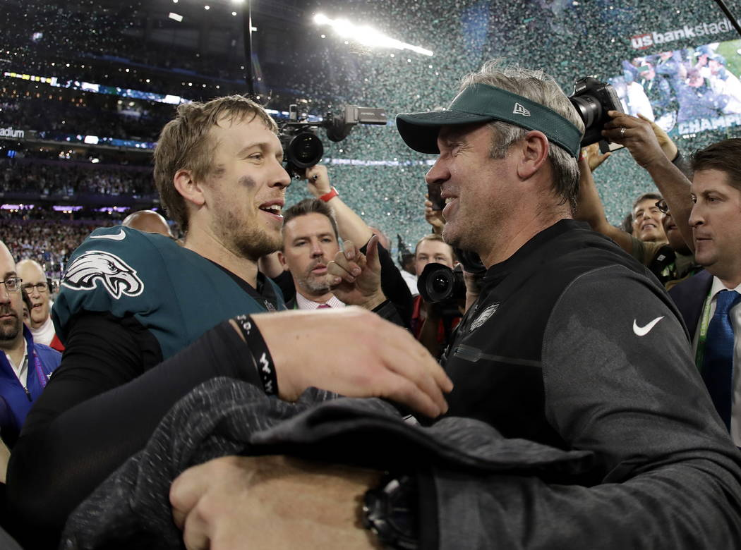 Philadelphia Eagles' Nick Foles, left, celebrates with head coach Doug Pederson after the NFL Super Bowl 52 football game against the New England Patriots Sunday, Feb. 4, 2018, in Minneapolis. The ...