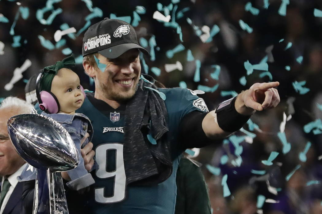 Philadelphia Eagles quarterback Nick Foles (9) holds his daughter, Lily James, after winning the NFL Super Bowl 52 football game against the New England Patriots, Sunday, Feb. 4, 2018, in Minneapo ...