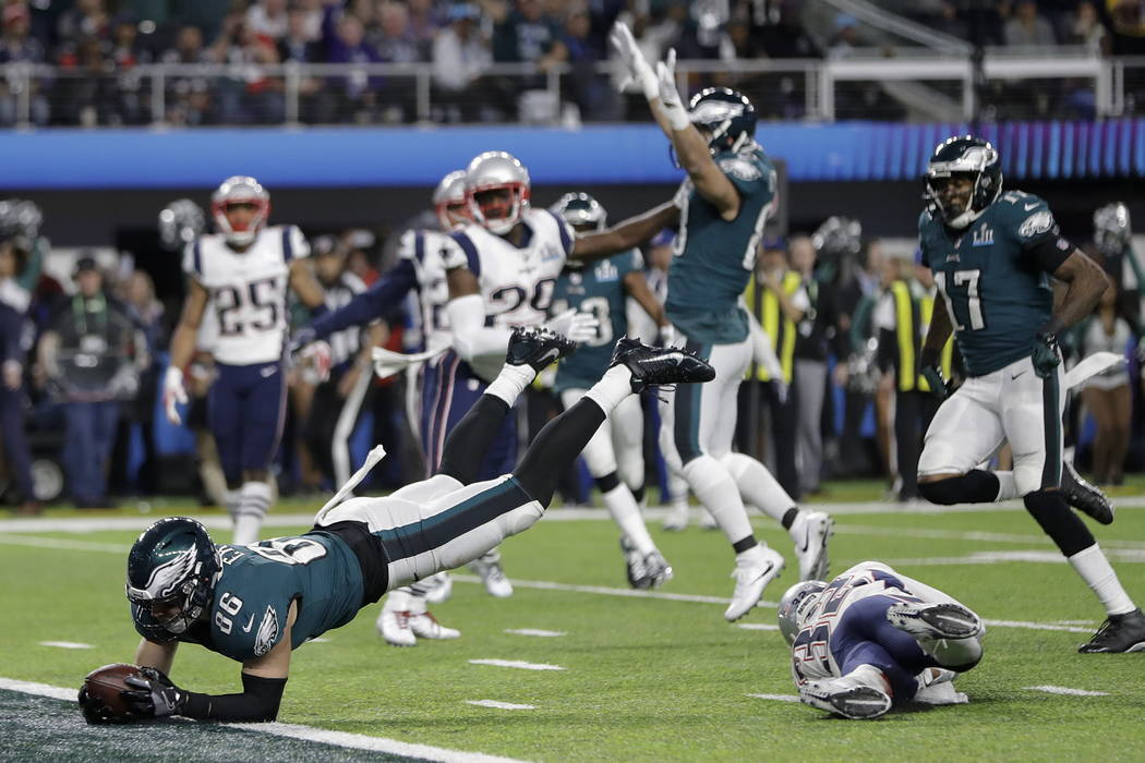 Philadelphia Eagles' Zach Ertz dives into the end zone for a touchdown during the second half of the NFL Super Bowl 52 football game against the New England Patriots Sunday, Feb. 4, 2018, in Minne ...