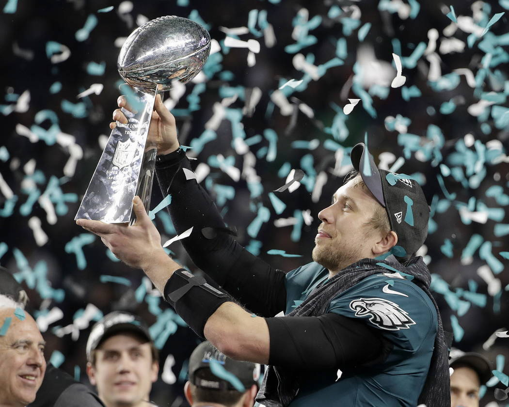 Philadelphia Eagles' Nick Foles holds up the Vince Lombardi Trophy after the NFL Super Bowl 52 football game against the New England Patriots, Sunday, Feb. 4, 2018, in Minneapolis. The Eagles won  ...
