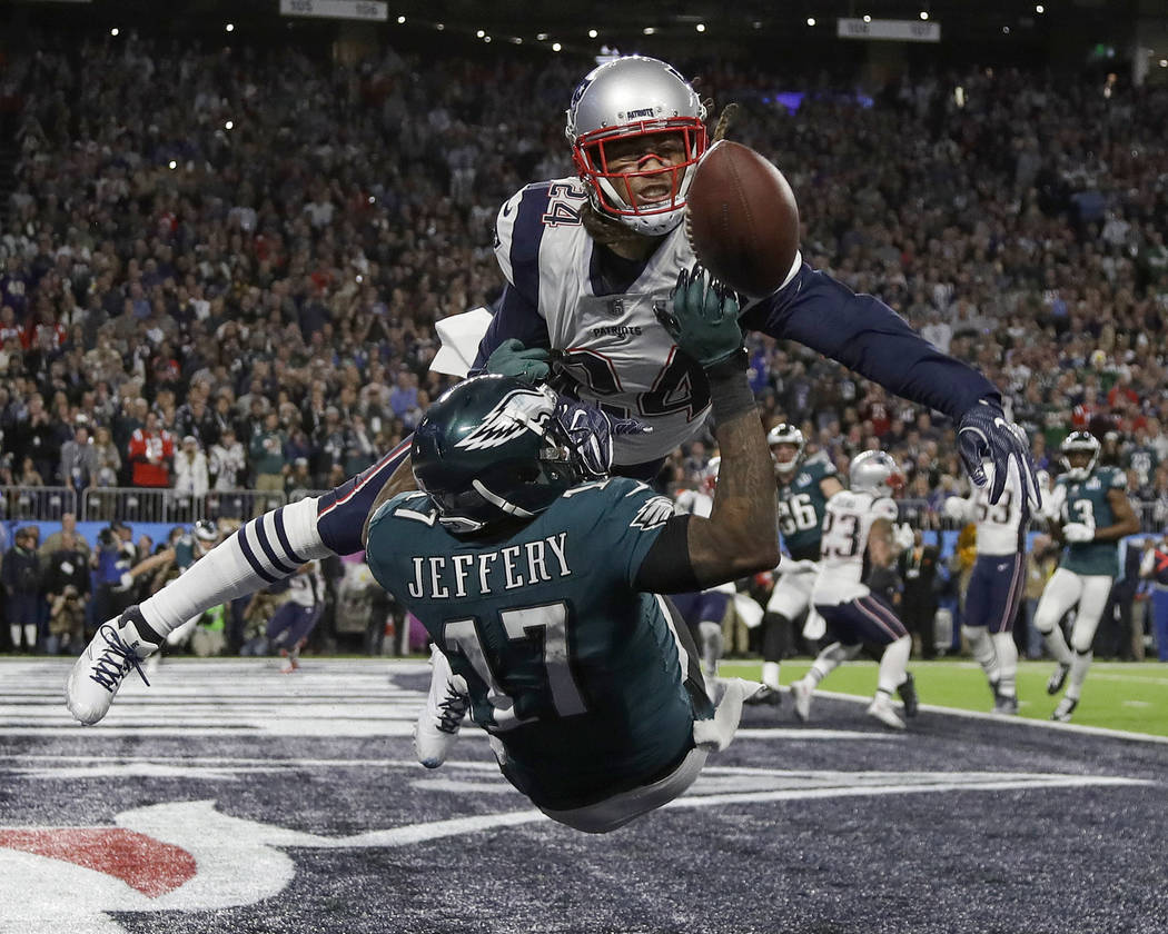 New England Patriots' Stephon Gilmore, top, breaks up a pass intended for Philadelphia Eagles' Alshon Jeffery during the first half of the NFL Super Bowl 52 football game Sunday, Feb. 4, 2018, in  ...