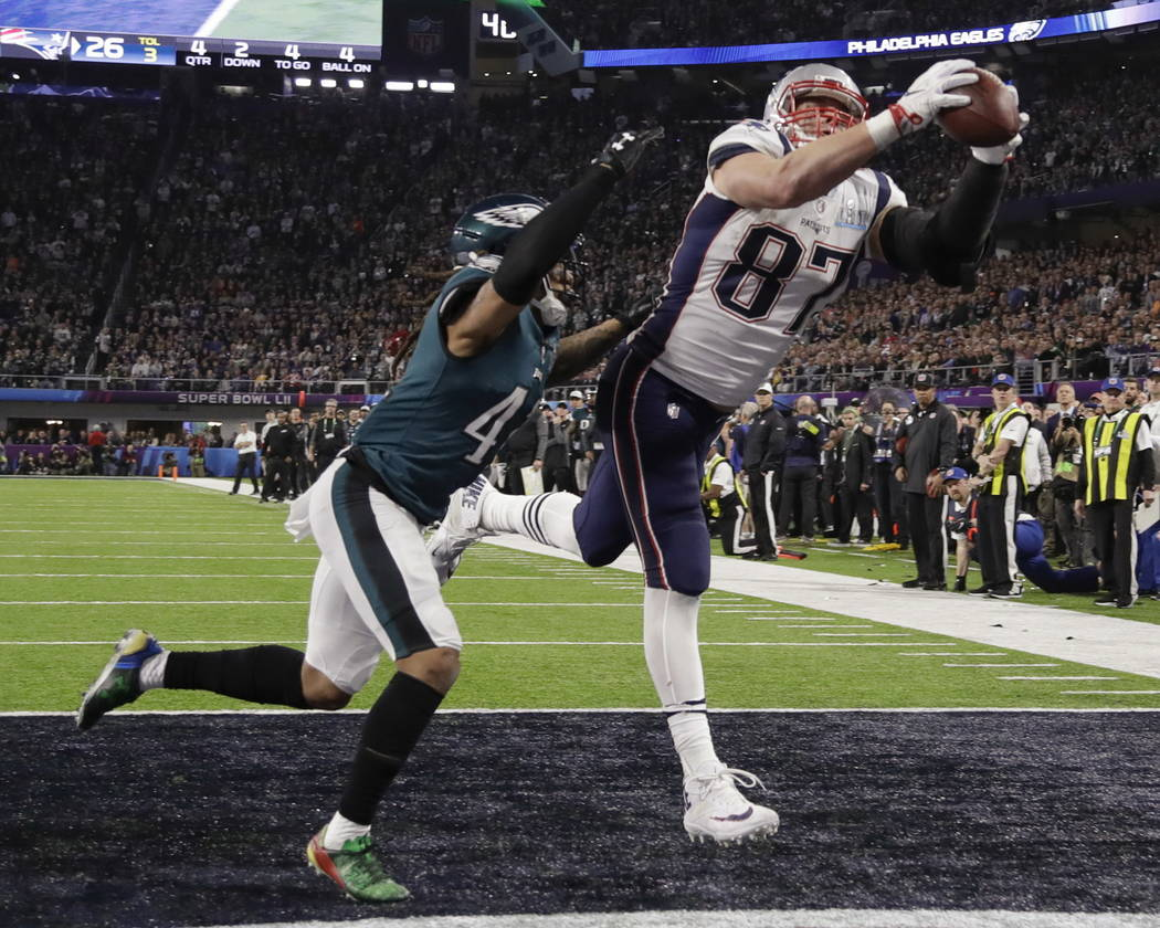 New England Patriots' Rob Gronkowski (87) makes a touchdown reception against Philadelphia Eagles cornerback Ronald Darby (41), during the second half of the NFL Super Bowl 52 football game, Sunda ...