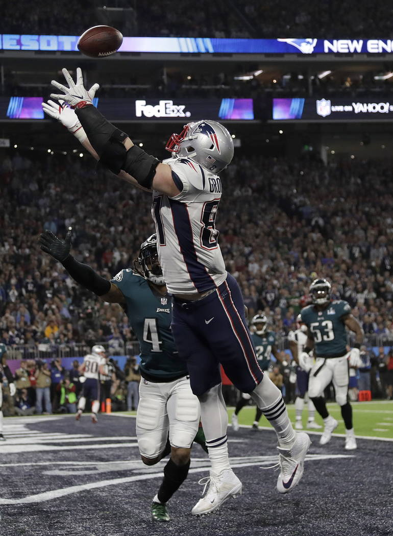 New England Patriots' Rob Gronkowski, top, catches a touchdown pass in front of Philadelphia Eagles' Ronald Darby during the second half of the NFL Super Bowl 52 football game Sunday, Feb. 4, 2018 ...