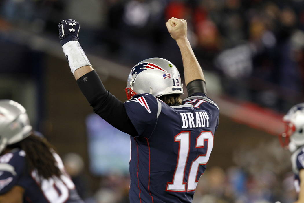 New England Patriots quarterback Tom Brady (12) celebrates a touchdown against the Tennessee Titans during the first half of an NFL divisional playoff football game, Saturday, Jan. 13, 2018, in Fo ...