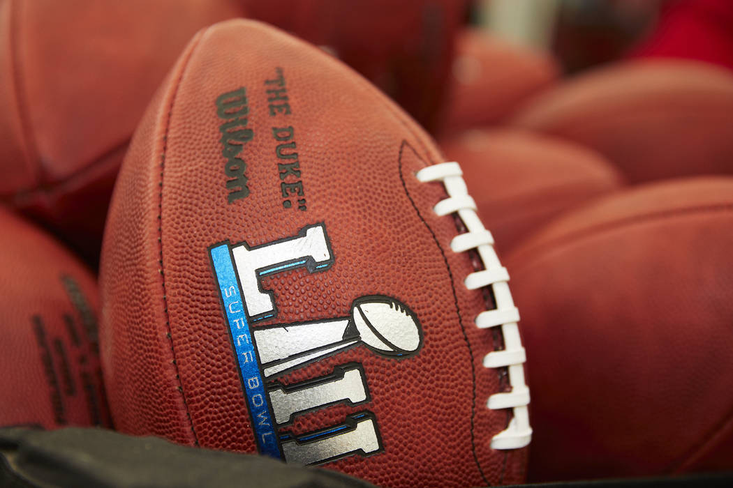 Official balls for the NFL Super Bowl LII football game are seen at the Wilson Sporting Goods Co. in Ada, Ohio, Monday, Jan. 22, 2018. The New England Patriots will play the Philadelphia Eagles in ...