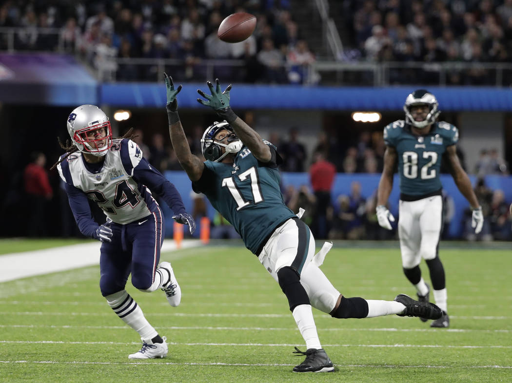 Philadelphia Eagles wide receiver Alshon Jeffery (17) makes a catch against New England Patriots cornerback Stephon Gilmore (24), during the first half of the NFL Super Bowl 52 football game Sunda ...