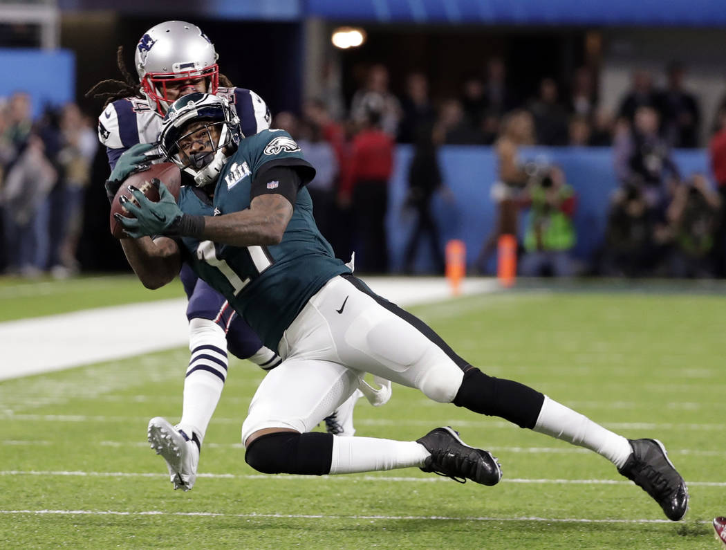 Philadelphia Eagles wide receiver Alshon Jeffery (17) makes a catch against New England Patriots cornerback Stephon Gilmore (24), during the first half of the NFL Super Bowl 52 football game, Sund ...