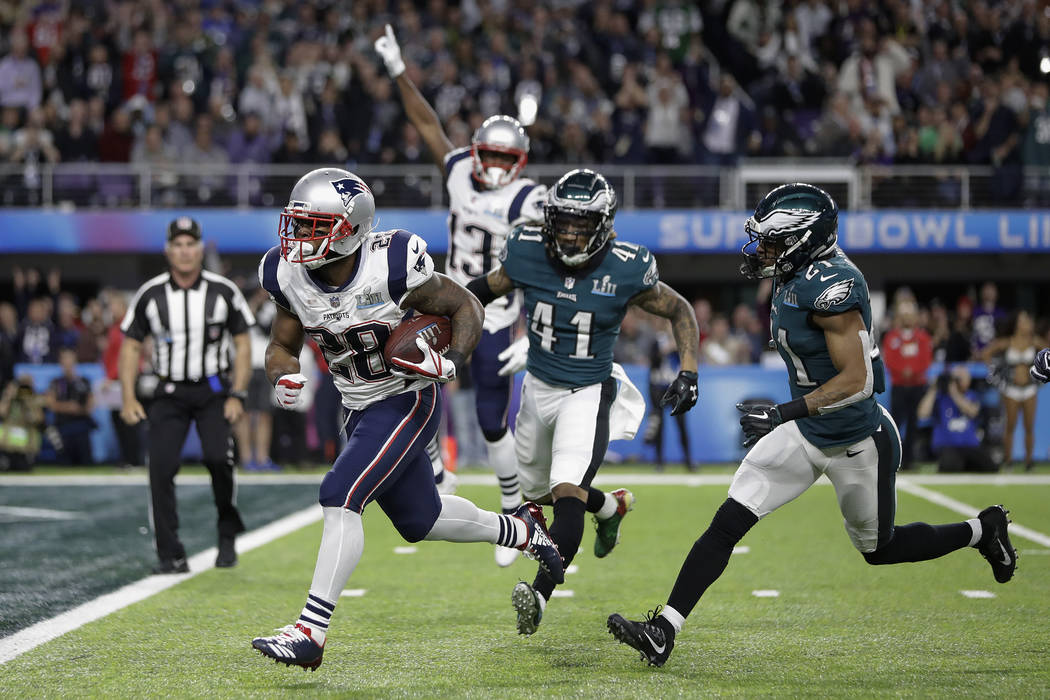 New England Patriots' James White runs for a touchdown during the first half of the NFL Super Bowl 52 football game against the Philadelphia Eagles Sunday, Feb. 4, 2018, in Minneapolis. (AP Photo/ ...