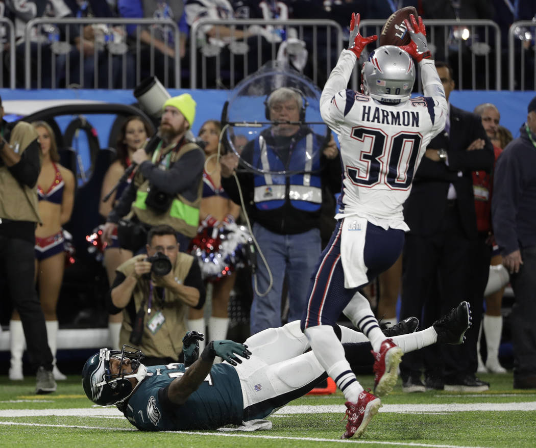 New England Patriots strong safety Duron Harmon (30) grabs a ball for an interception after Philadelphia Eagles wide receiver Alshon Jeffery (17), misses a catch during the first half of the NFL S ...